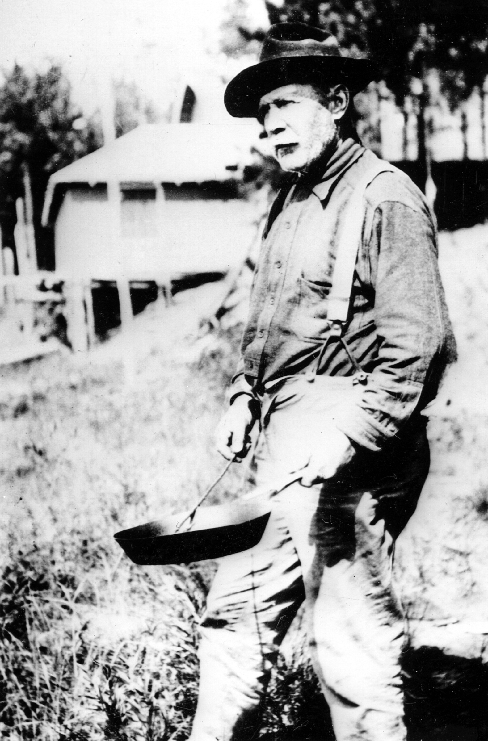 William McArthur, a Trout Lake fishing guide, preparing a shore lunch, circa 1915. He and his wife, Sophie, homesteaded McArthur's Island in Trout Lake. From Northwoods Memories, courtesy of Harold and Jill Haling.