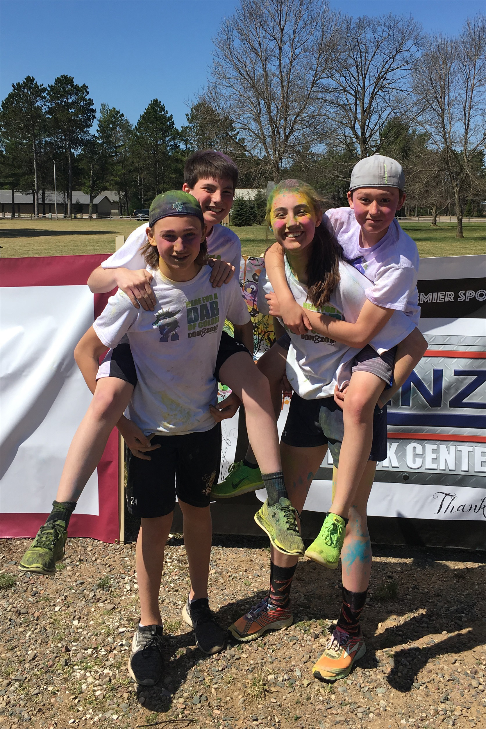 Leo, Teag, Kira and Gray are covered with colored powder from the Color Run in Minocqua. Kim Johnson photo