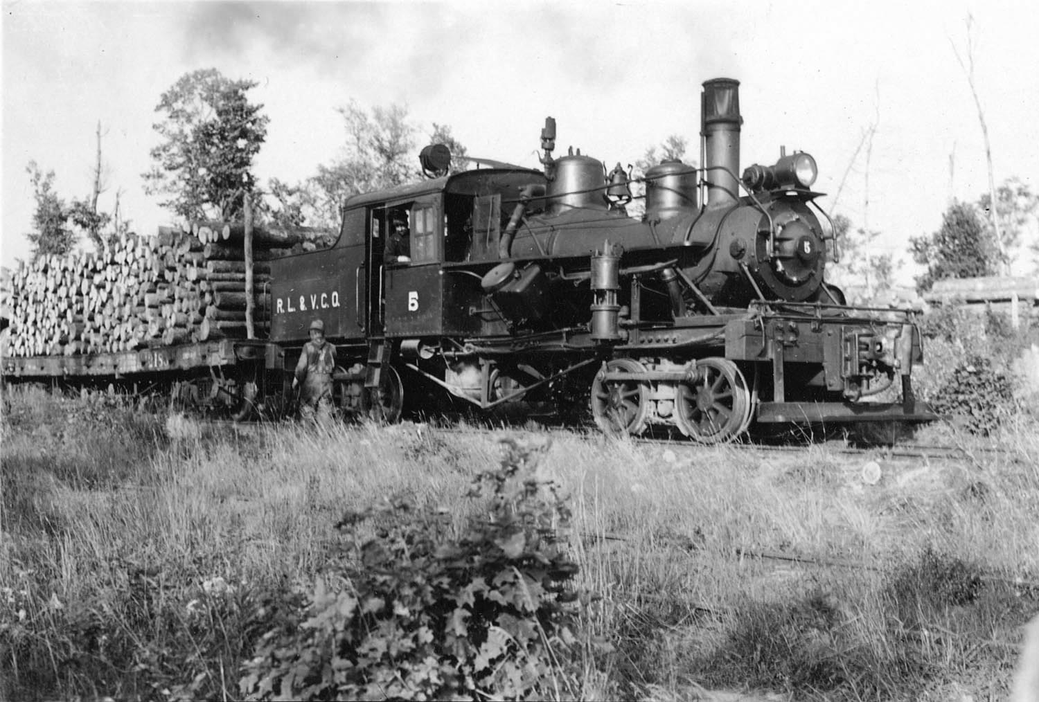 Logging train hauling lumber. Taken in 1937 in Mercer, Iron County. Wisconsin Department of Natural Resources photo