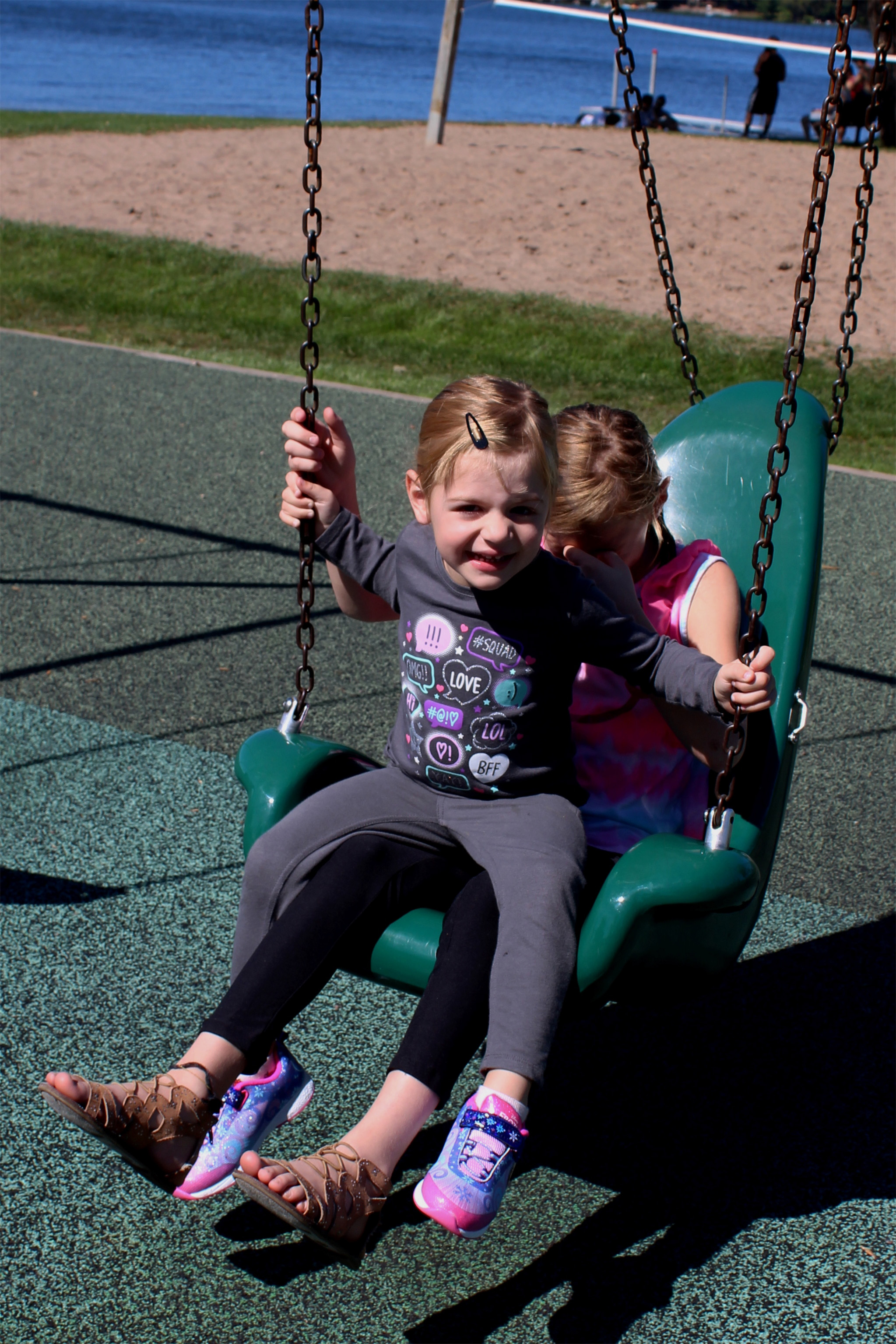 Sisters Ava and Addyline enjoy swinging together at Torpy Park in Minocqua. Kim Johnson photo