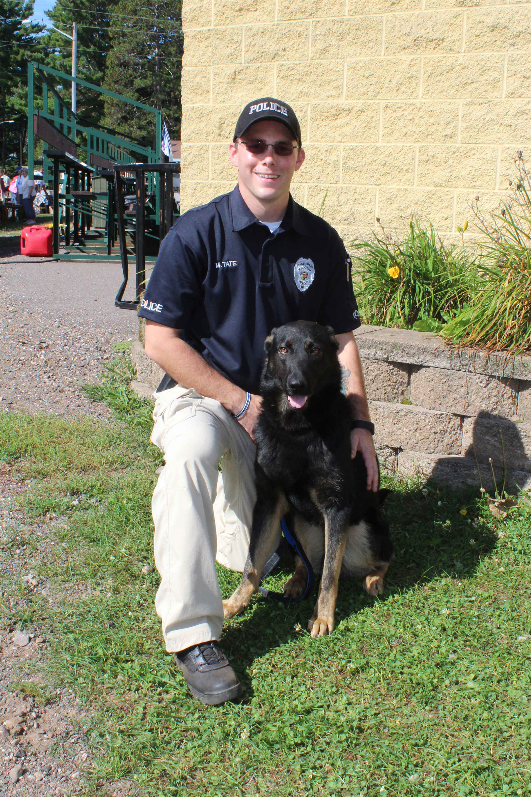Officer Matthew Tate with his K9 partner, Jennings, in Lake Tomahawk. Kim Johnson photo
