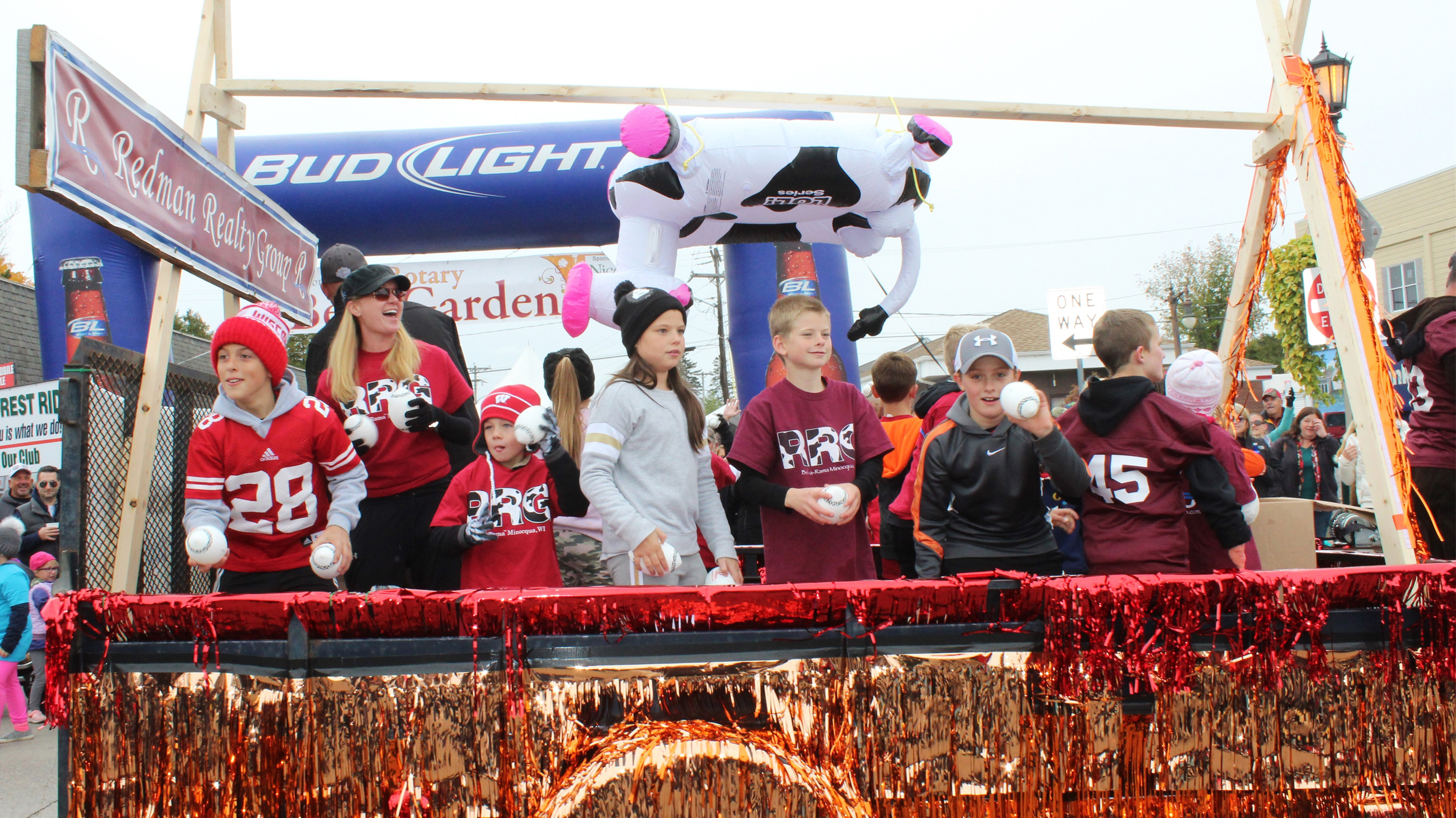 In Minocqua, riders on the Redman Realty float tossed footballs to spectators at the Beef-A-Rama parade. Kim Johnson photo