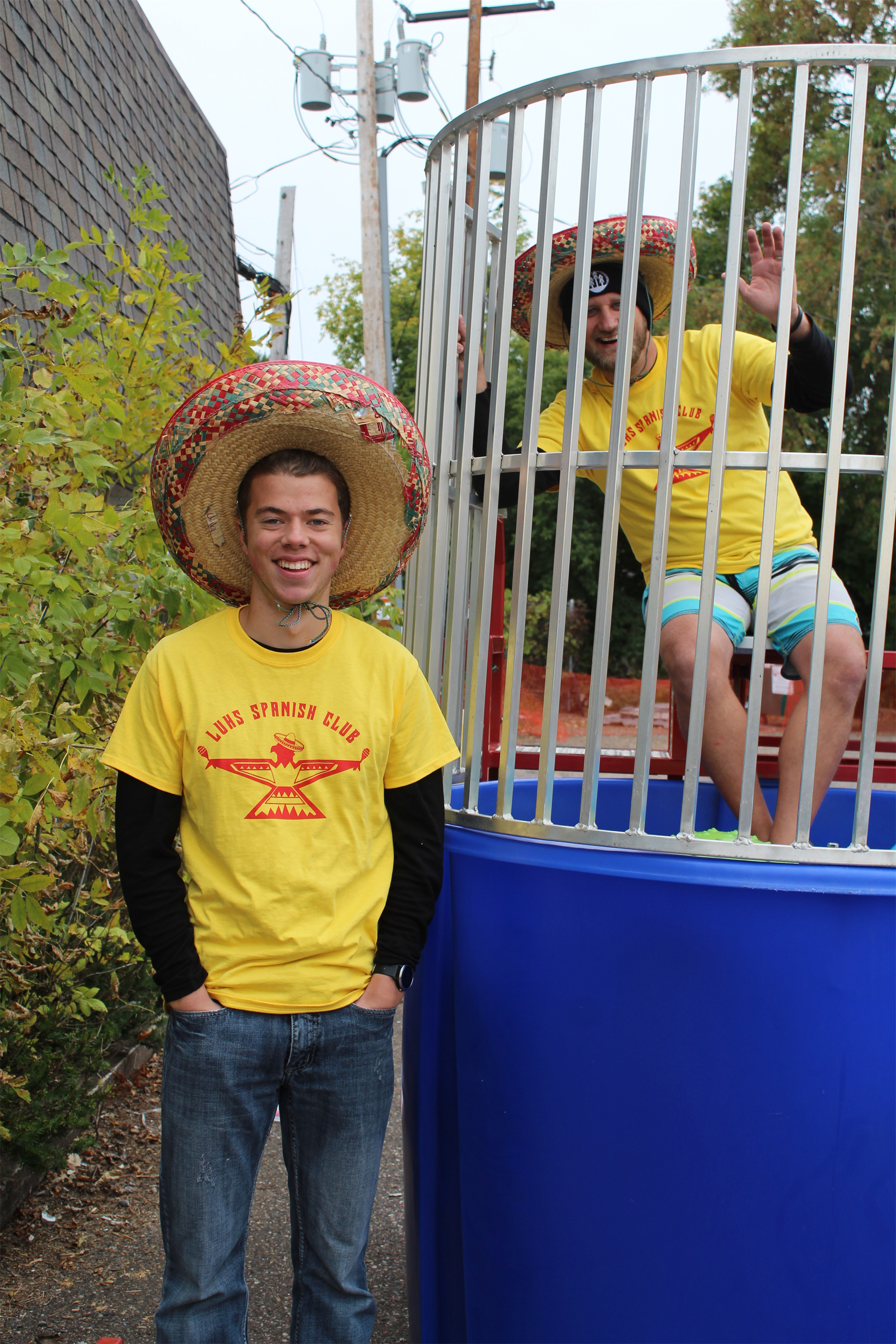 Aiden and Mr. Bremmer volunteer at the dunk tank for the Lakeland Spanish Club Fundraiser in Minocqua. Kim Johnson photo