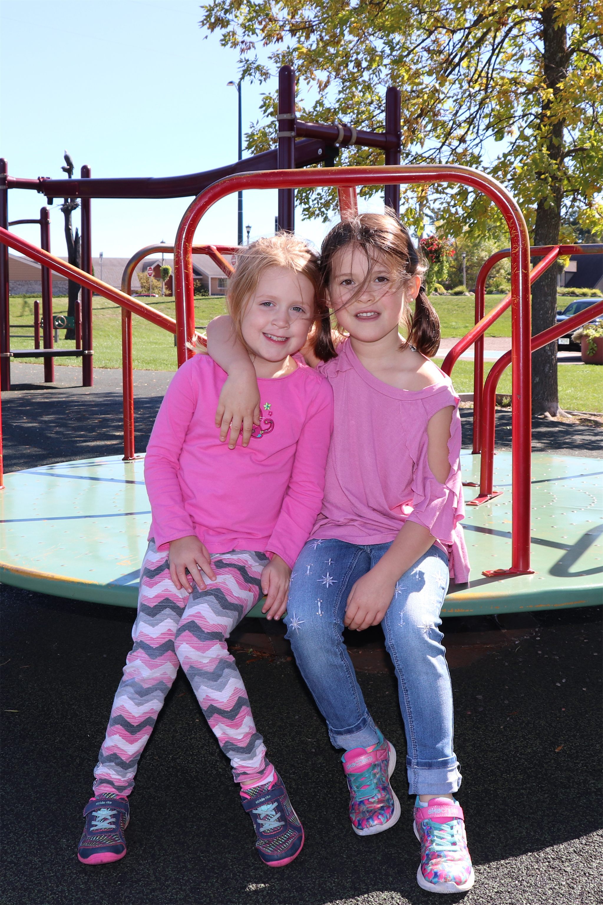 Pretty in pink, these girls enjoy the afternoon at Torpy Park in Minocqua. Kim Johnson photo
