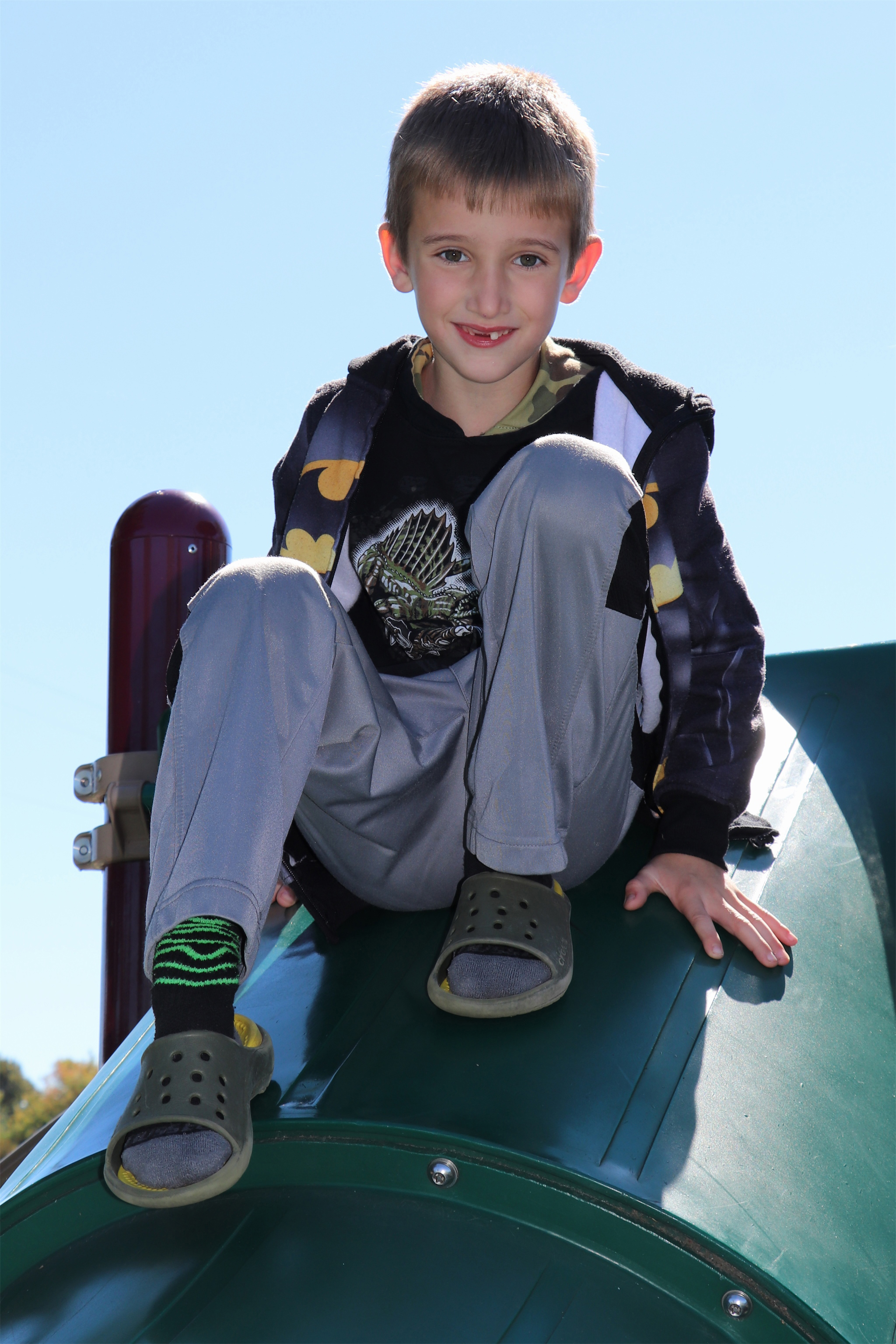 This boy playing at Torpy Park in Minocqua is all smiles. Kim Johnson photo