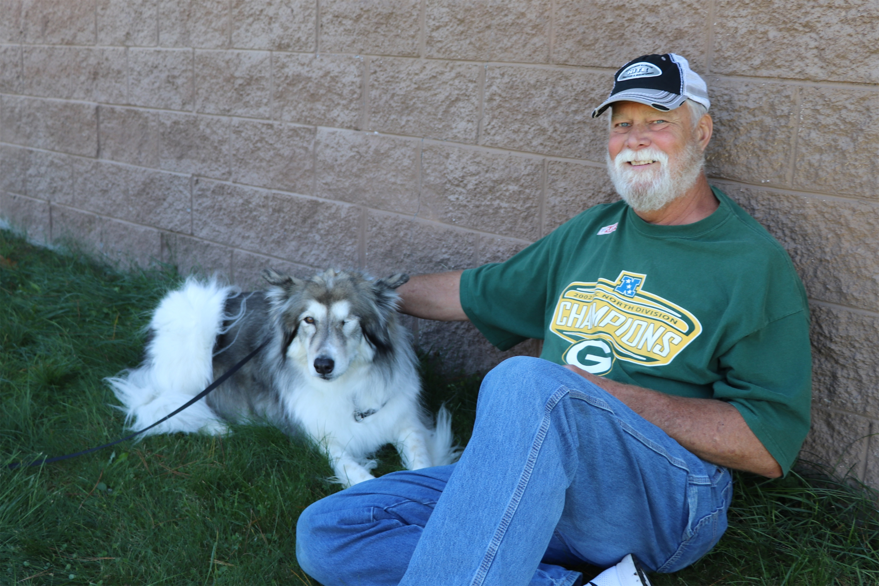This gentleman and his dog relax in the shade at the park in St. Germain. Kim Johnson photo