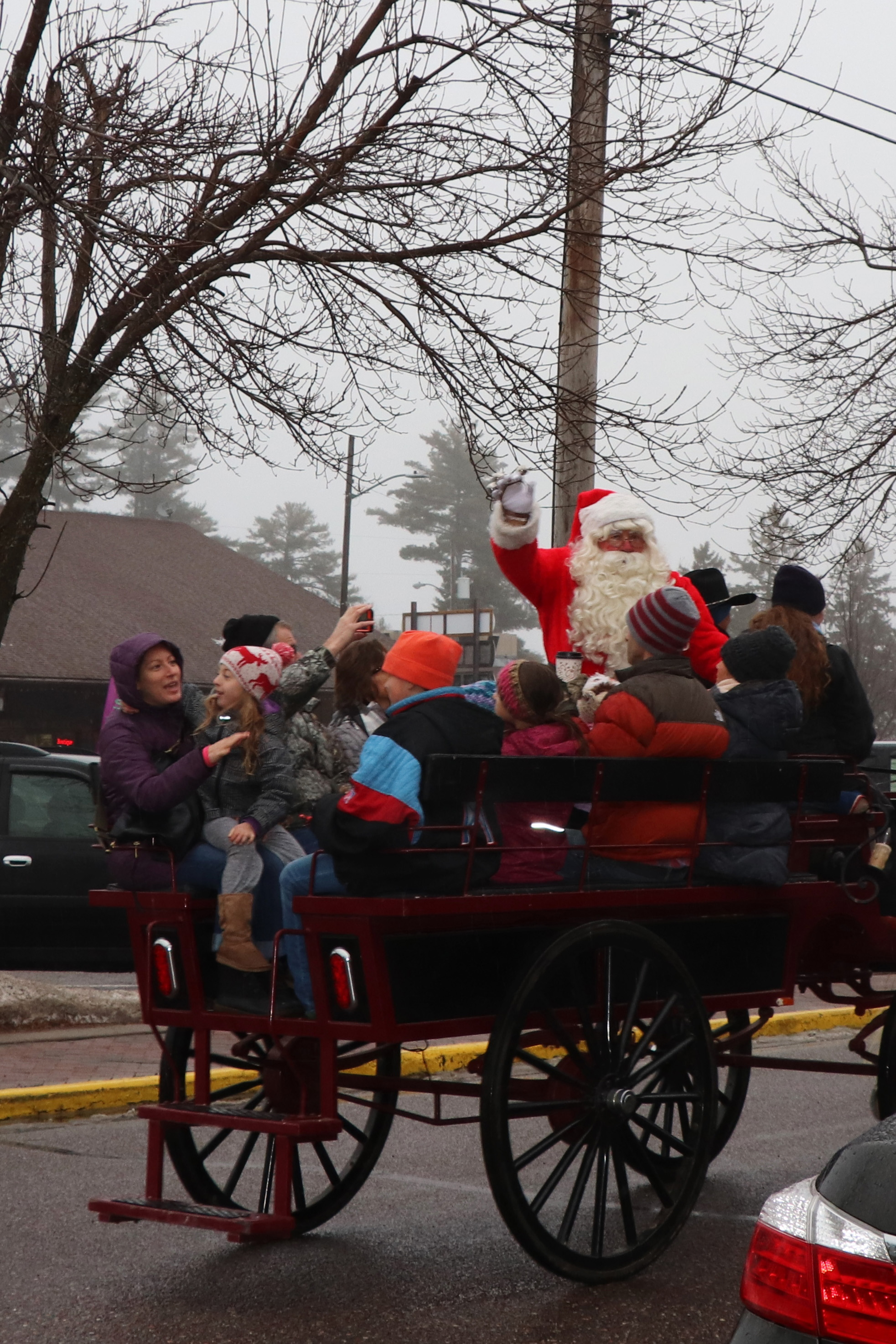 Santa recently made a stop in downtown Minocqua for his annual horse-drawn wagon ride. Kim Johnson photo