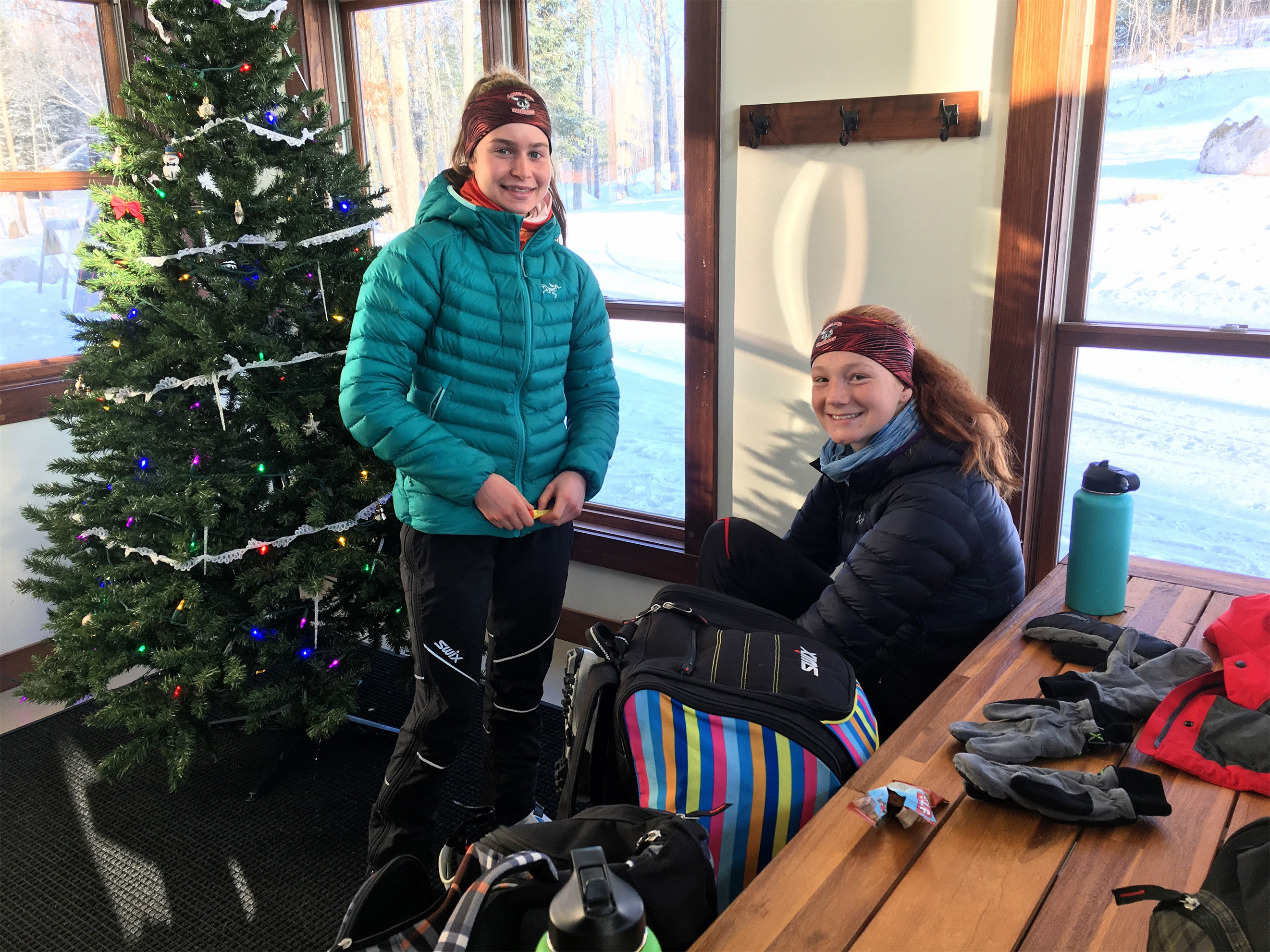 Ashley and Kate warm up at the WinMan Trails shelter, Manitowish Waters. Kim Johnson photo