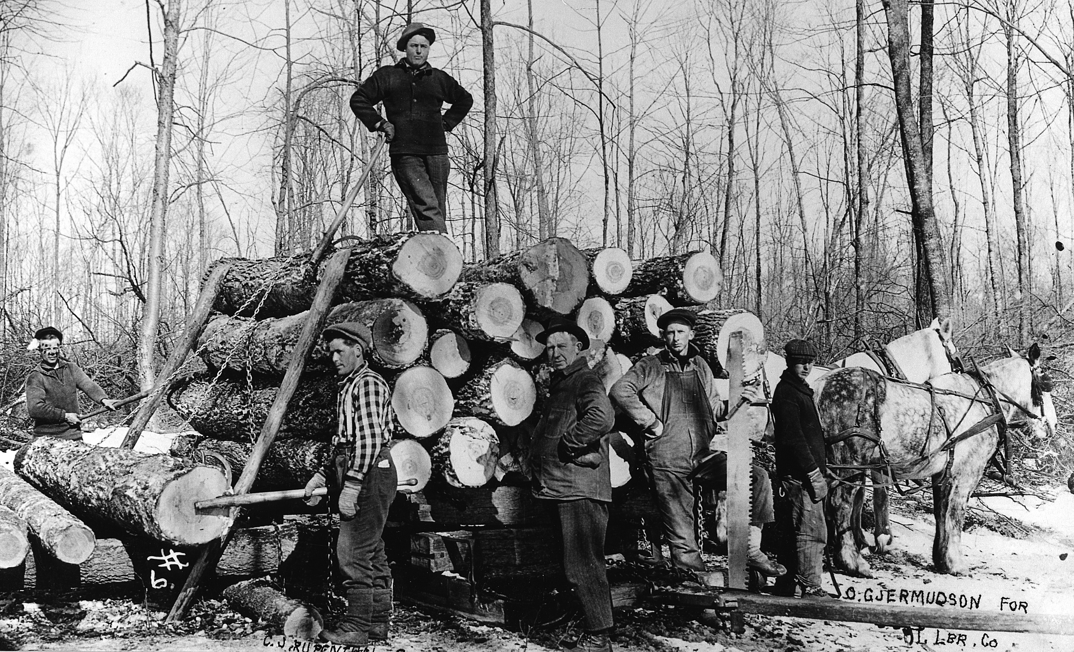 Tigerton Lumber Company. Oliver Jermundson is second from the right. Courtesy of Minocqua Museum