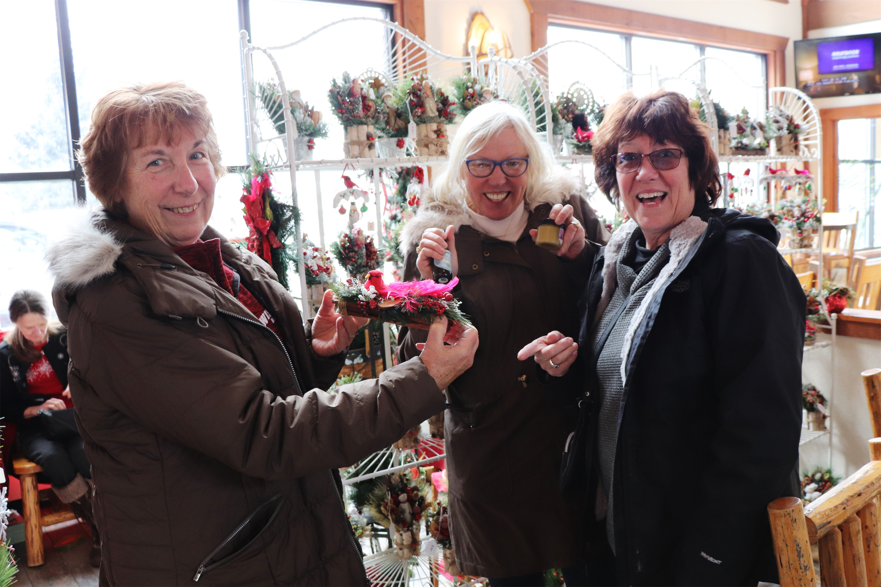 These ladies enjoy looking at the Christmas crafts at the annual Holiday Market in Minocqua. Kim Johnson photo