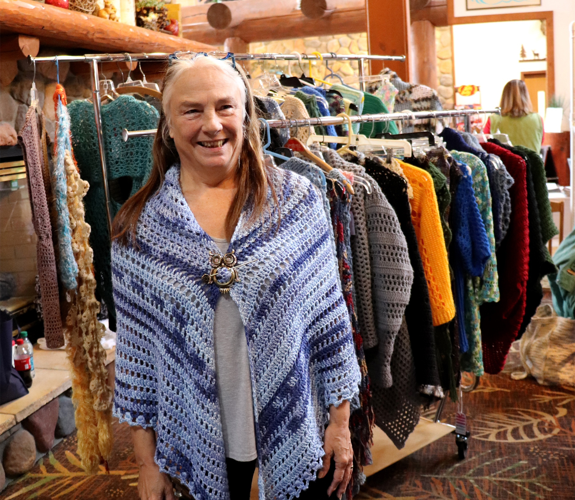 Charlotte Anderson of Charlotte's Webs shows off her handmade sweaters. Kim Johnson photo