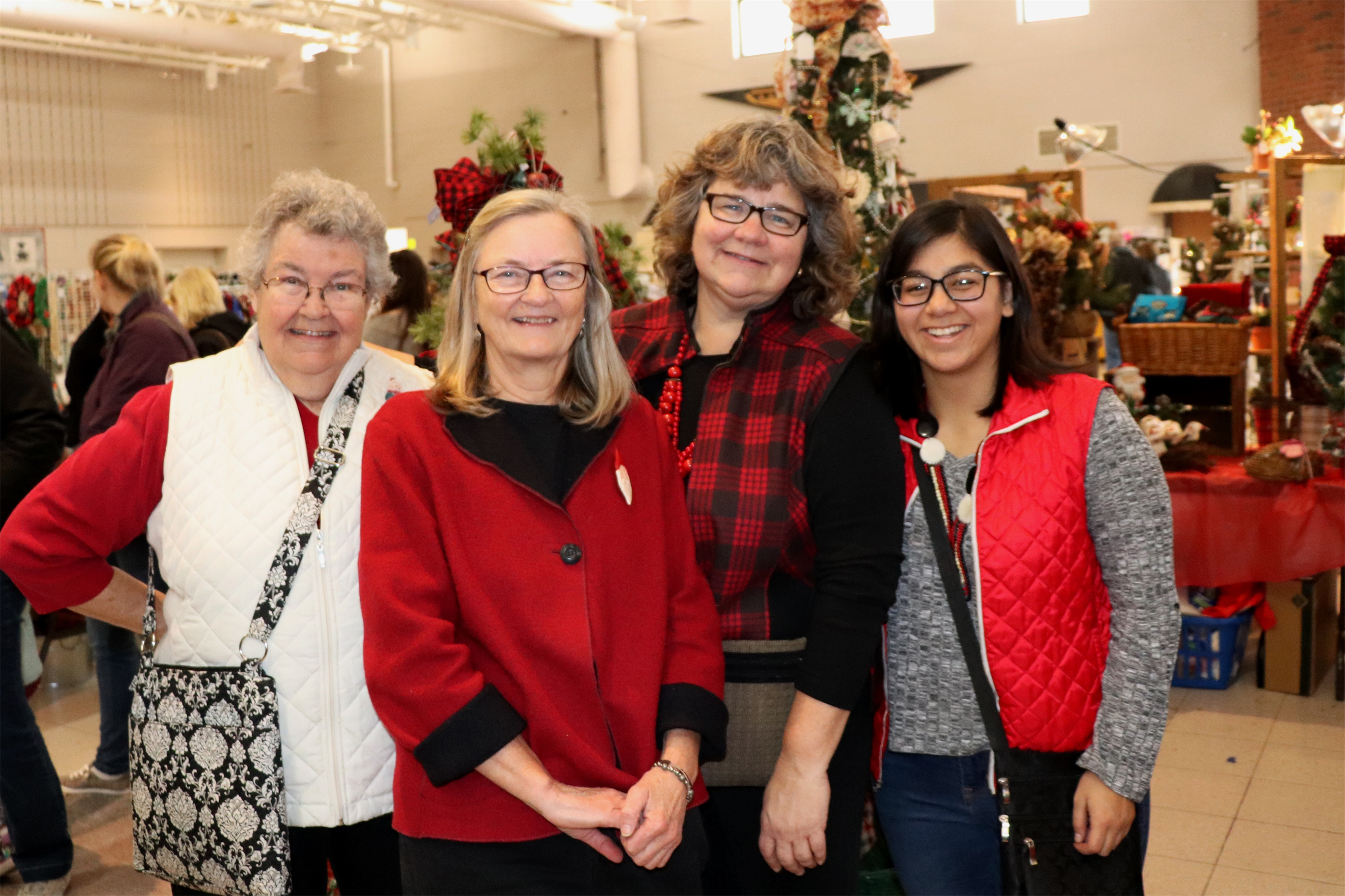 Bonnie, Marie, Kirsten and Marie share time together at the Christmas Gift and Craft Show in Minocqua. The women, who represent three generations, make and sell their crafts locally. Kim Johnson photo