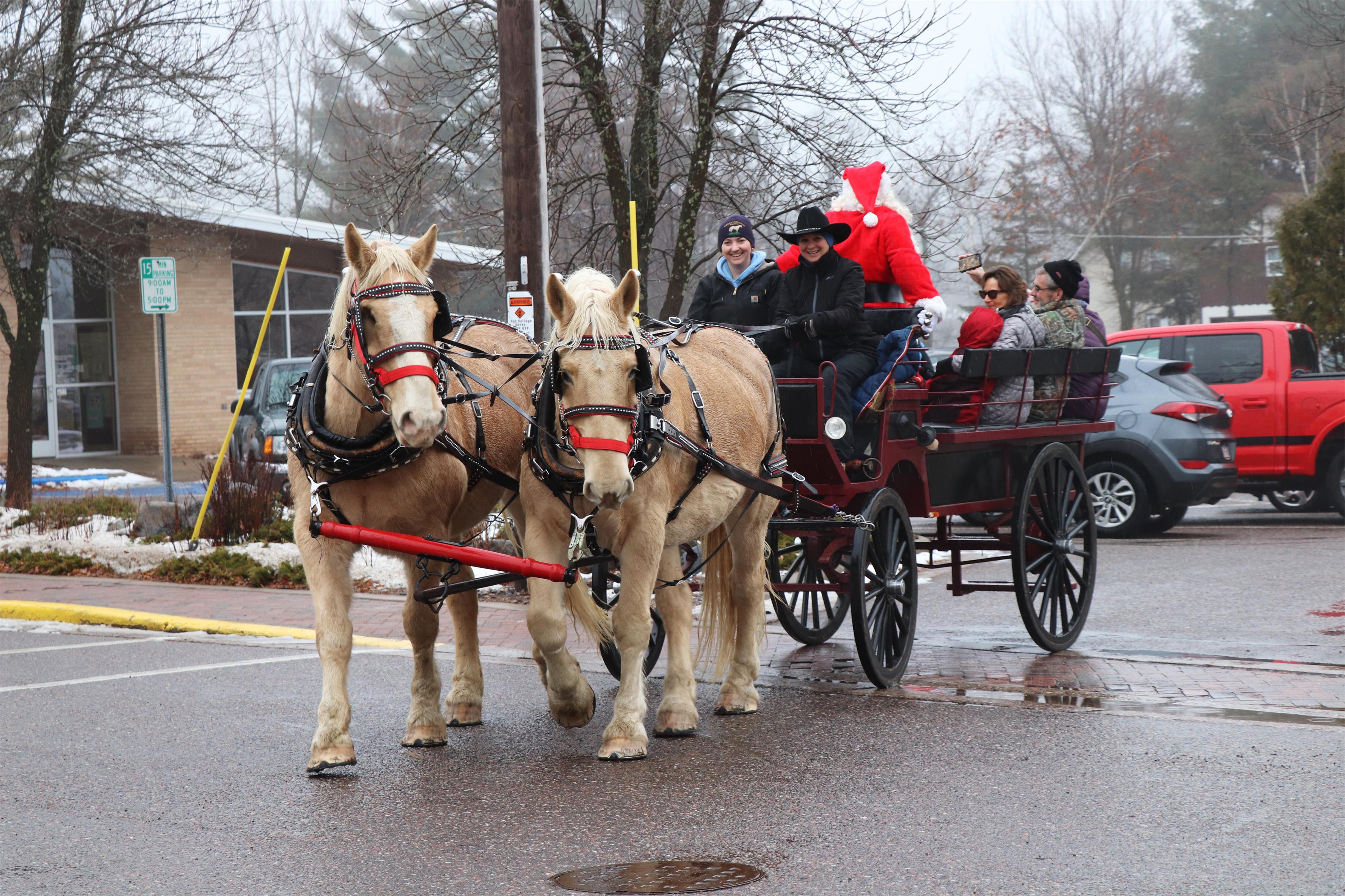 Visitors enjoy horse-drawn wagon rides with Santa at Christmas in Minocqua. Kim Johnson photo