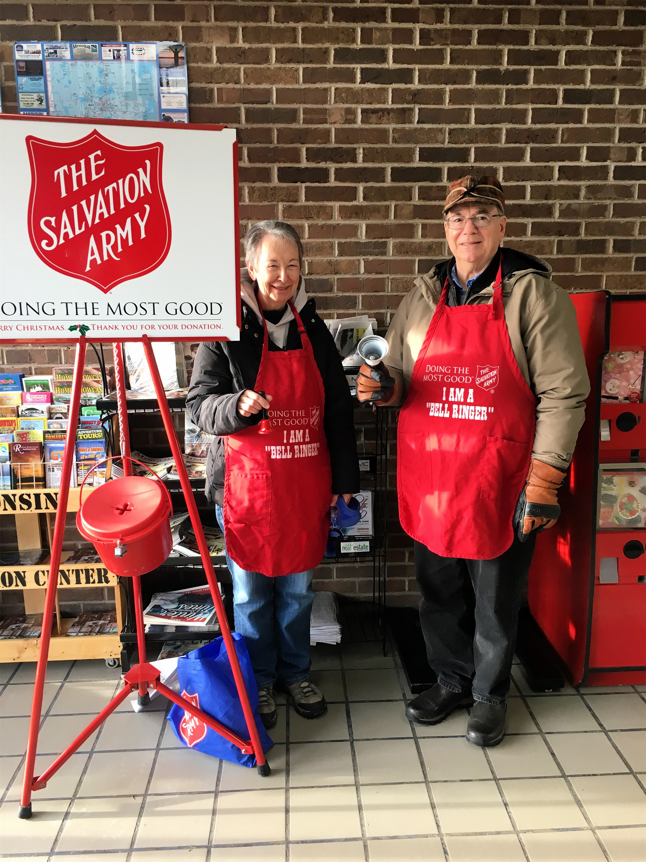 John and Susan of Ascension Lutheran Church volunteer to ring bells for The Salvation Army at Save More Foods in Minocqua. Kim Johnson photo