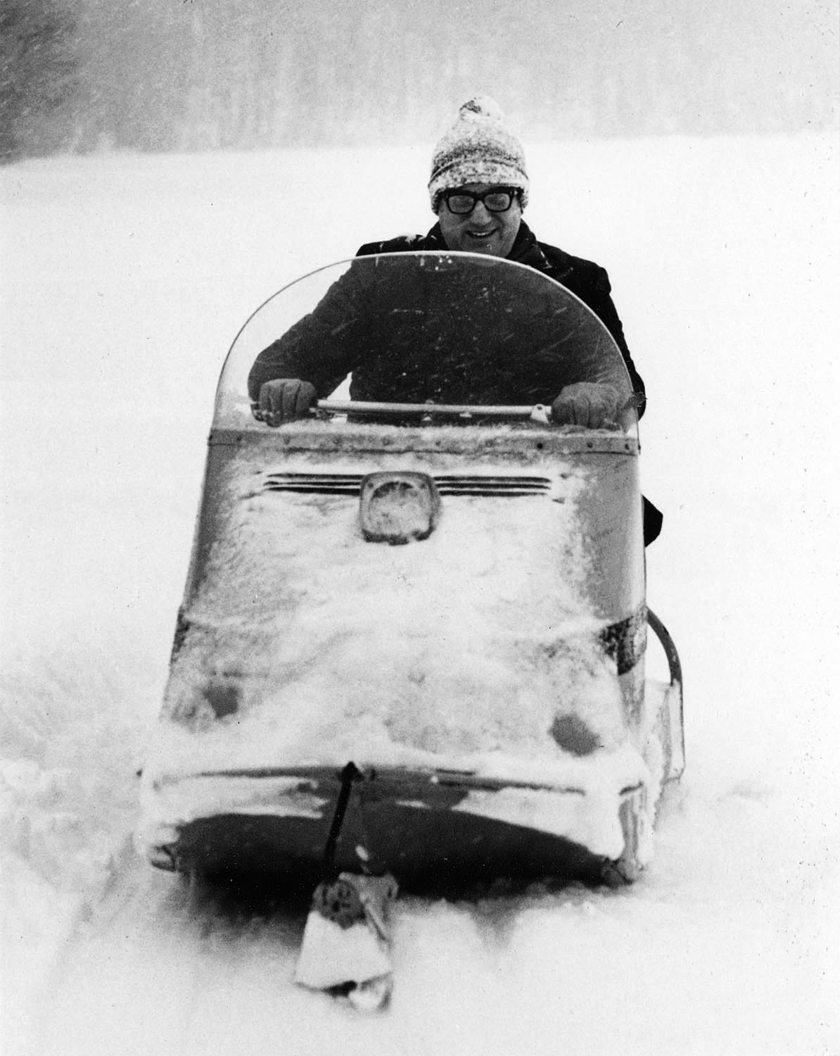 Department of Natural Resources Secretary Lester P. Voigt running a snowmobile. Taken in 1969. Wisconsin Department of Natural Resources photo