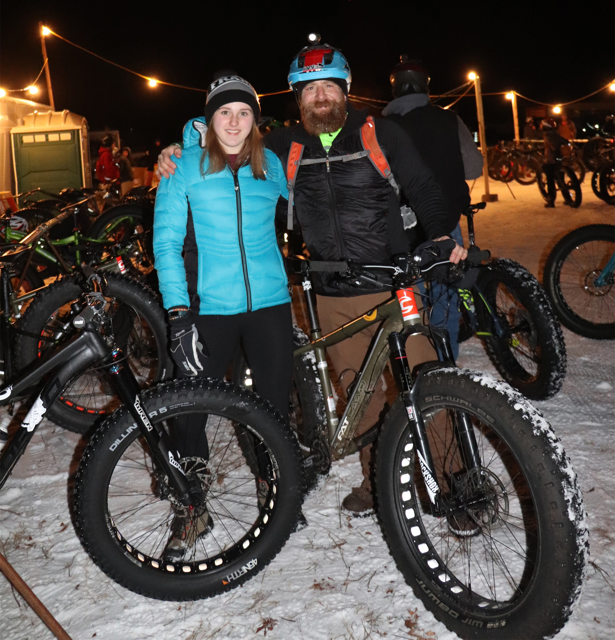 Frank and his daughter Sam pose for a photo at the Fat Bike by Candlelight event in Minocqua. Kim Johnson photo