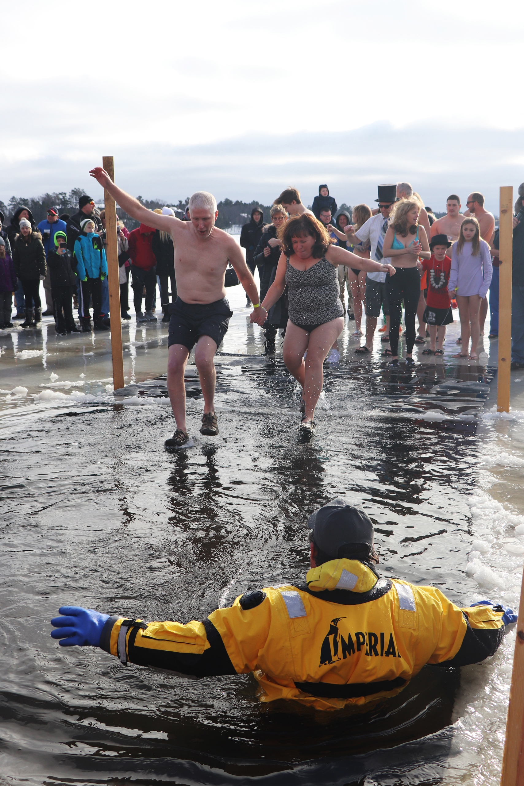 These two brave the cold at the Chill Out Polar Plunge in Minocqua. The event benefits the Children's Miracle Network. Kim Johnson photo