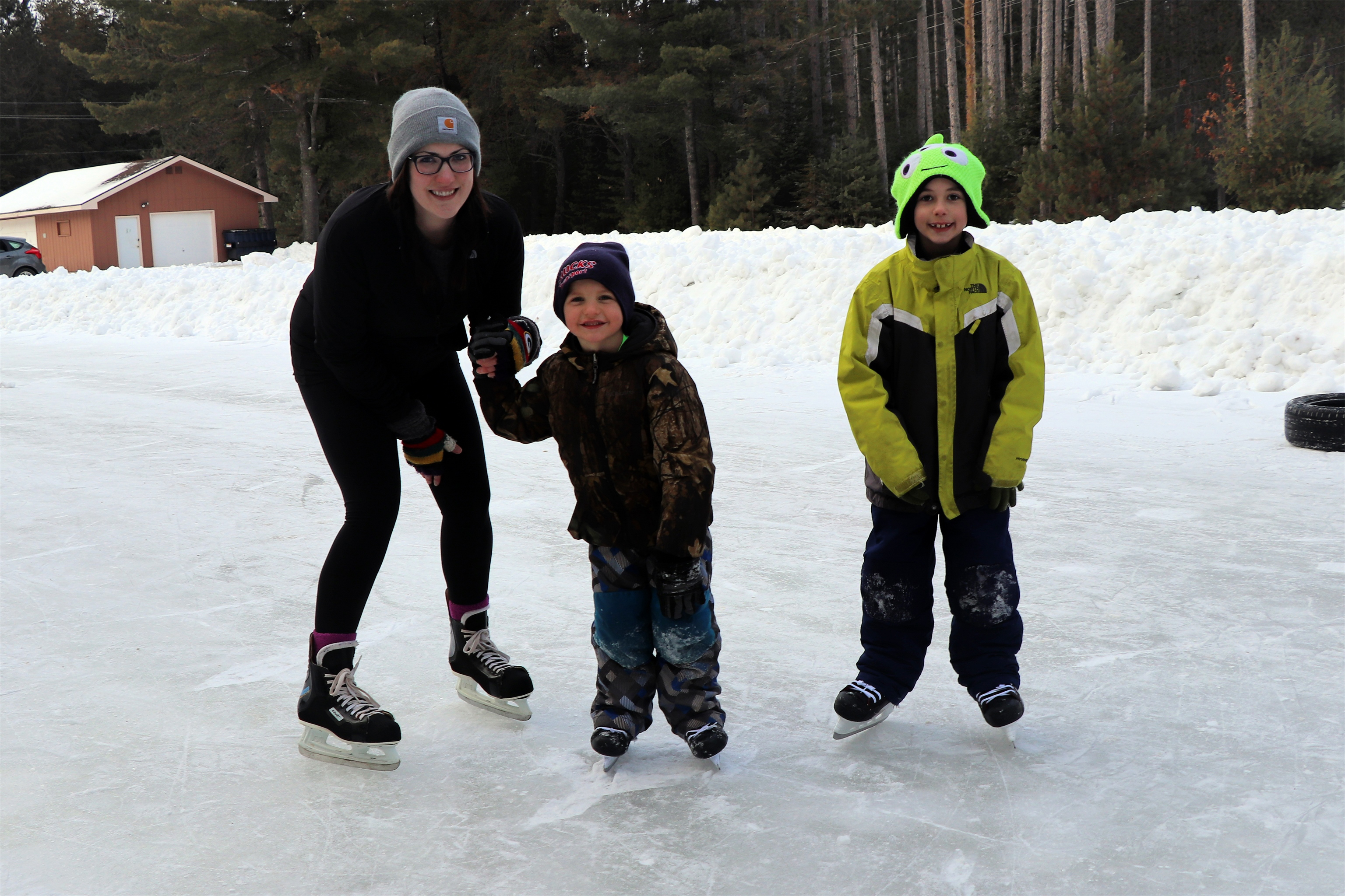 Angela and her boys Elliott and Tristan spend time ice skating at Brandy Park in Woodruff. Kim Johnson photo