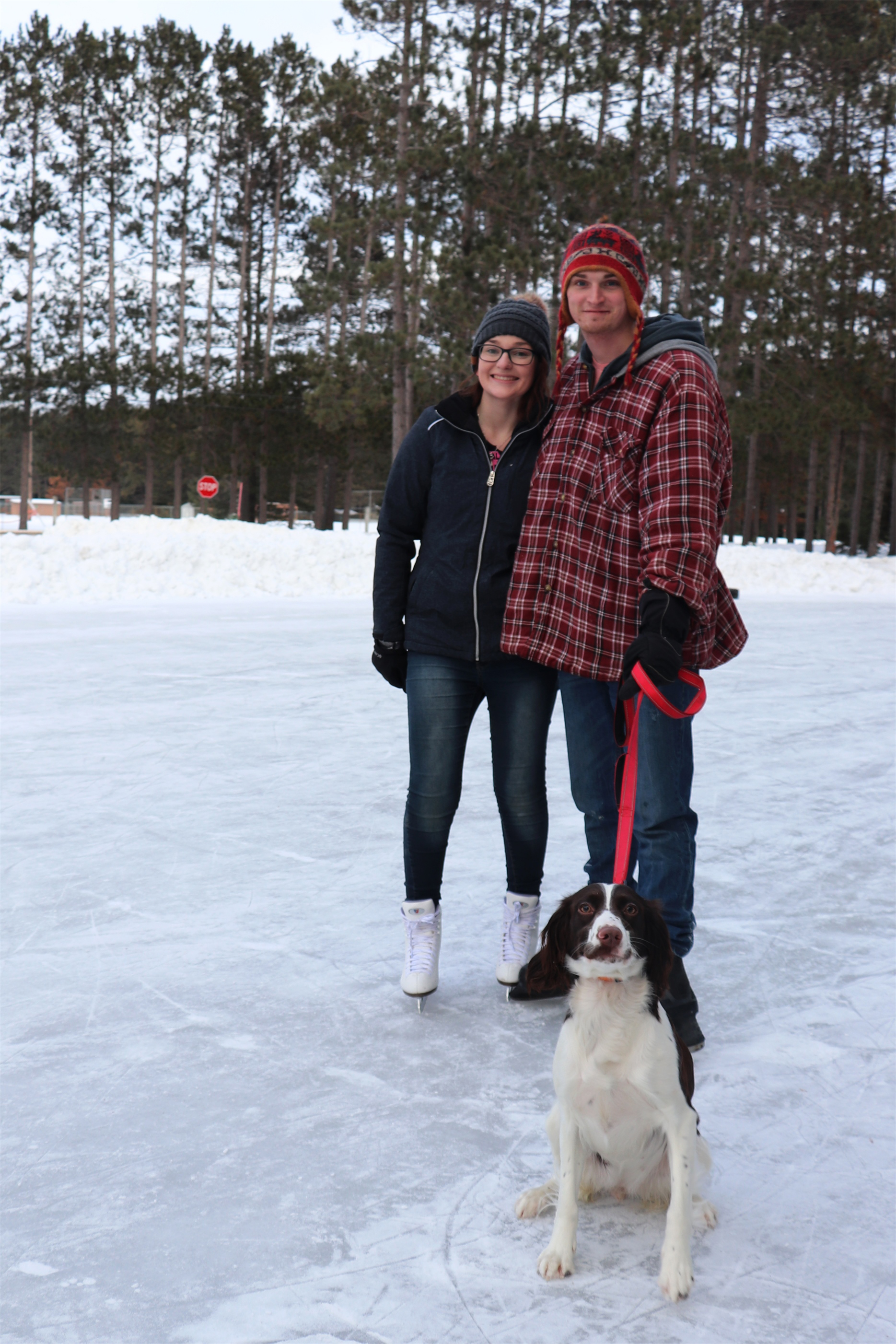 Addison and Caleb play with their dog Jolene on the ice in Woodruff. Kim Johnson photo