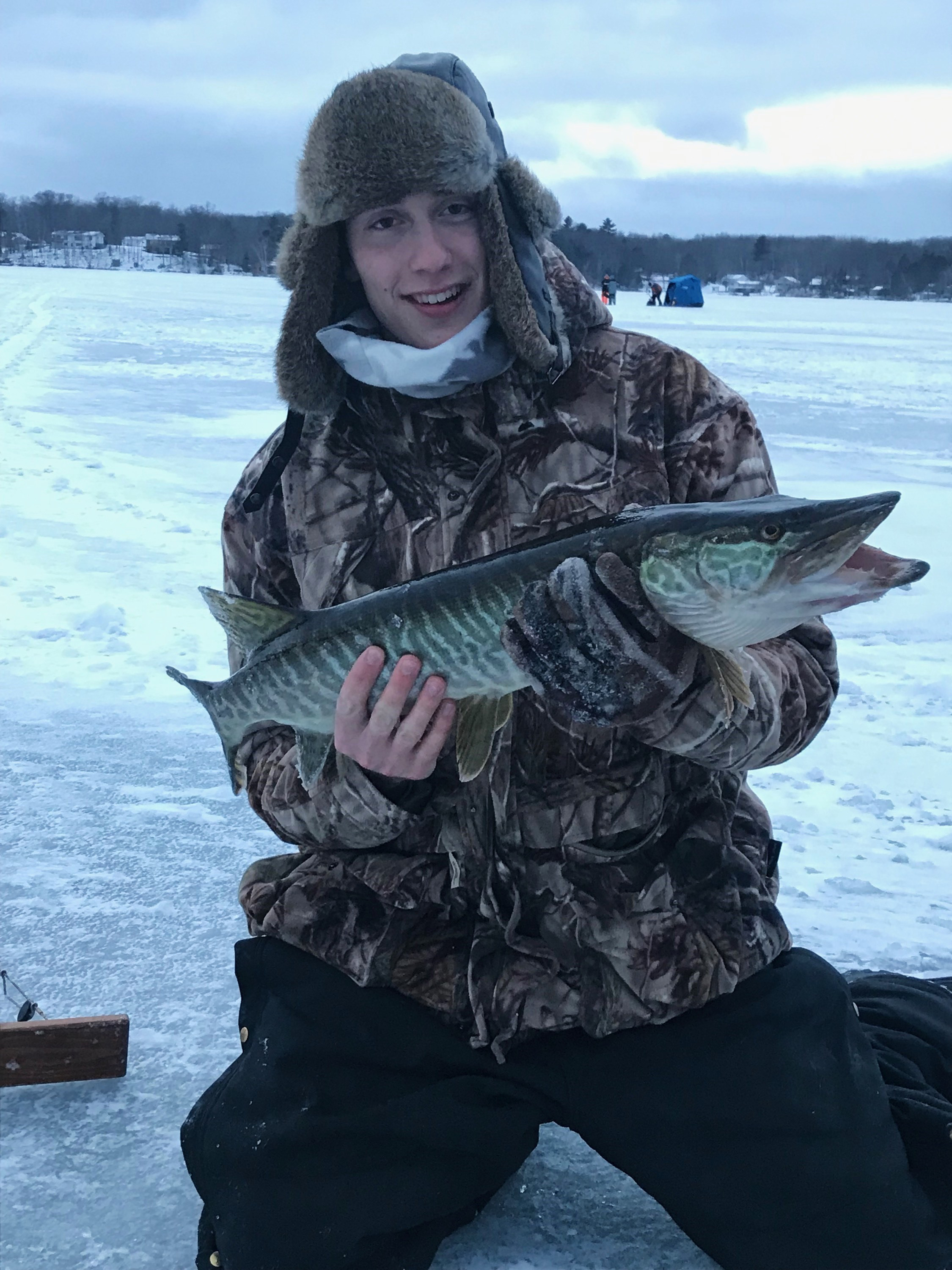 Mason shows off a nice tiger musky caught in the Lakeland area. Submitted photo